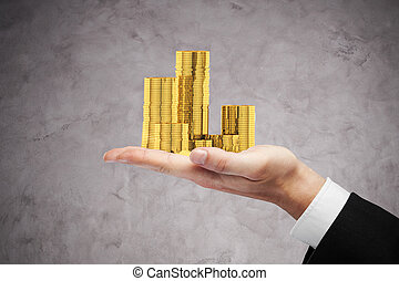 Businessman holding coins - Businessman hand holding golden...