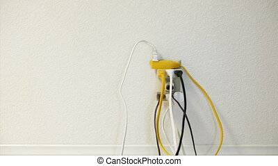 Overloaded Electrical Outlet - Man plugging another cord...