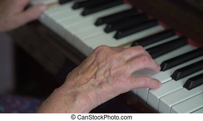 Grandmother is playing the piano