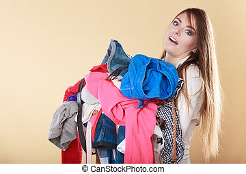 Woman carrying dirty laundry clothes. - Young woman carrying...