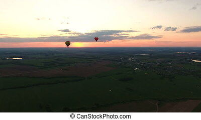 Hot air balloons in the sky over a fieldAerial view - Hot...