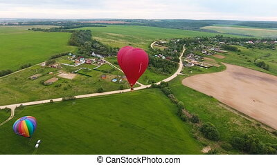 Hot air balloons in the sky over a field.Aerial view
