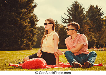 Moody girl with boyfriend in park - Love romance heartbreak...