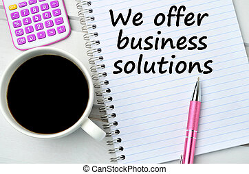 The words We offer business solutions on notebook