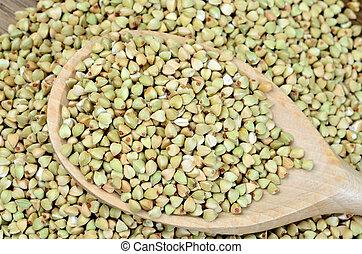 Green buckwheat in spoon - Green buckwheat in wooden spoon