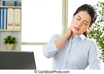 Young asian business woman with pain in neck in office