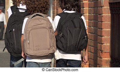 Elementary Students Wearing Backpacks