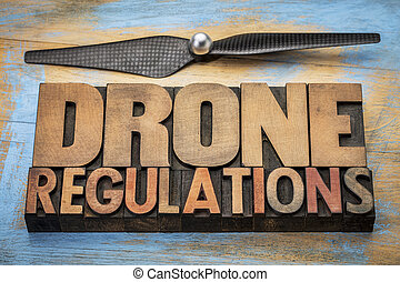 drone regulations word abstract invintage letterpress wood...