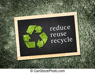 Top view of recycle symbol and quot;reduce reuse...