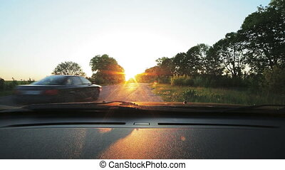 Point-of-view, cars on road. Look through car windscreen