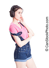 woman listening to music - Young woman listening to music on...