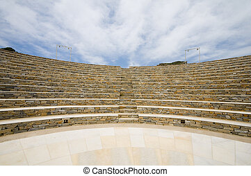 modern amphitheater overlooking the Aegean Sea and Milopotas...