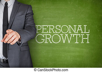 Personal growth on blackboard with businessman