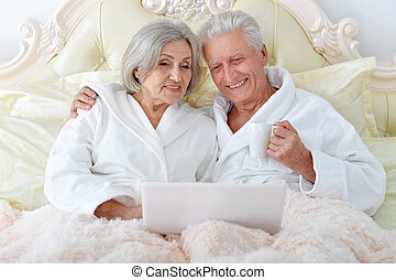 Senior couple in bed - happy Senior couple in bed with...