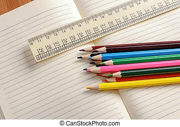 Crayons, a ruler and Notepad closeup