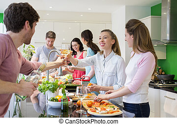Friends Preparing A Meal - A group of friends are preparing...