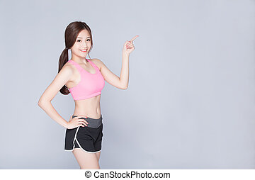 sport woman smiling pointing something