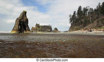Ruby Beach - Water flowing into the ocean, at rock covered...