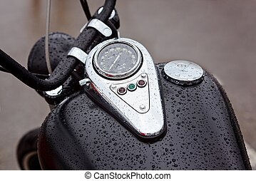 Tank with speedometer with warning lights on a motorbike in...
