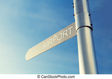 close up of airport signpost over blue sky - transportation,...