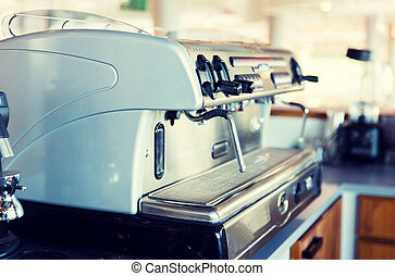 close up of coffee machine at bar or restaurant - equipment,...