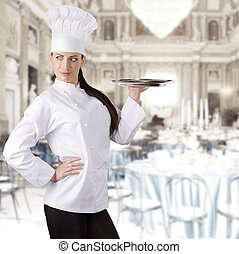 the chef - young graceful woman dressed as a cook with cap...