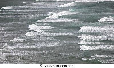 Oregon Coast - Waves roll in along the Oregon Coast