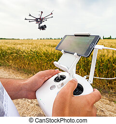 Unmanned copter. Man controls quadrocopter flight. -...