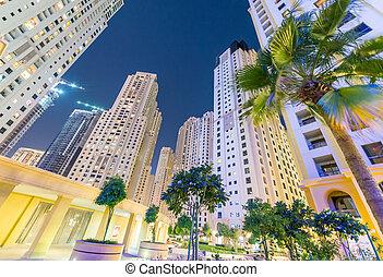 Dubai Marina skyline at night from street level, United Emirates
