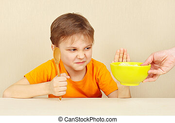 Little boy refuses to eat cereal