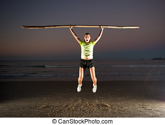 Sport Spirit - Woman doing exercises during sunset in...