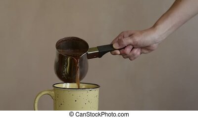 Pouring coffee into a big mug - Female hand pouring coffee...