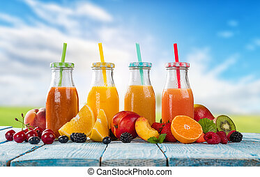 Fresh juice with fruit mix on wooden table