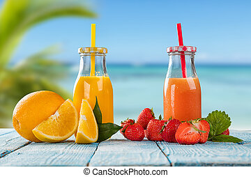 Fresh juice with fruit mix on the beach