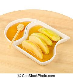 apples in honey - Dipping apples in honey for Rosh HaShana,...