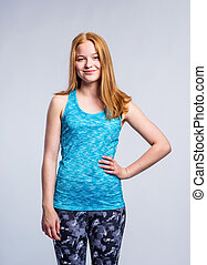 Girl in blue singlet and fitness leggings, young woman,...
