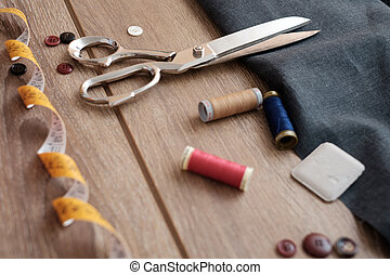 Collection of tailor tools on wooden table