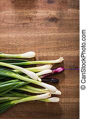 Leek on a wooden kitchen Table - Organic leek on a wooden...