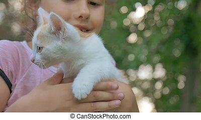 girl brunette holding kitten in her cat arms teen love...