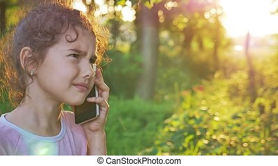 girl talking on phone behind sunset golden hour forest...