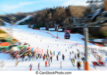 Blurred of the skier is skiing on the snow.