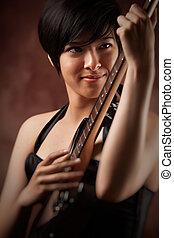 Attractive Multiethnic Girl Plays Her Guitar - Attractive...
