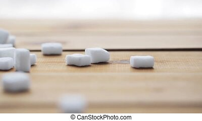 close up of white sugar on wooden board or table - food,...
