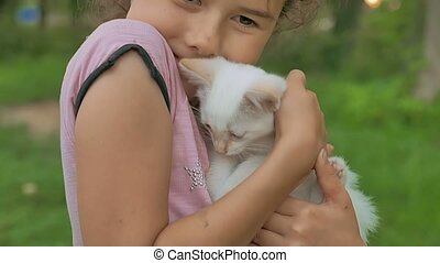 brunette girl holding kitten in her cat arms love teen...