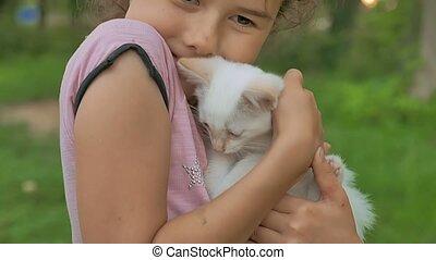 brunette girl holding kitten in her cat arms love teen...