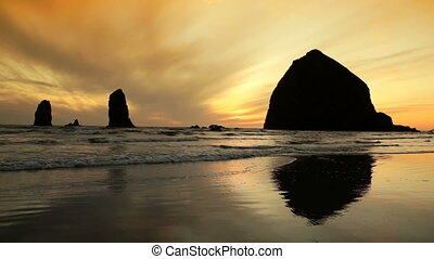 Oregon Coast - Silhouette Haystack Rock, Cannon Beach,...