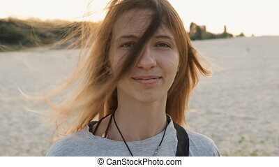 portrait of indy girl on the beach hair fluttering in the...
