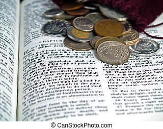 The Bible opened to the Book of Proverbs with Coins