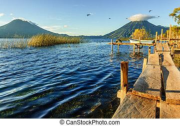Morning light on volcanoes, Lake Atitlan, Guatemala - Early...