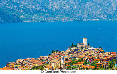 Top view to ancient tower and colorful houses in malcesine...